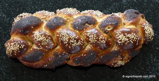 Six strand Tsoureki sprinkled with sesame and poppy seeds