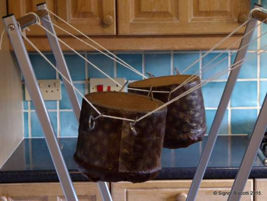 Panettone hanging upside down to cool